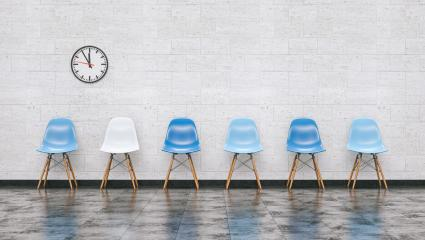 Row of blue chairs in a waiting room with wall clock, doctor and medical concept image - 3D rendering- Stock Photo or Stock Video of rcfotostock | RC-Photo-Stock