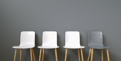 Row of chairs with one odd one out : Stock Photo or Stock Video Download rcfotostock photos, images and assets rcfotostock | RC-Photo-Stock.: