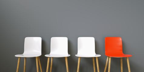 Row of chairs with one red. Job opportunity. Business leadership. recruitment concept- Stock Photo or Stock Video of rcfotostock | RC-Photo-Stock