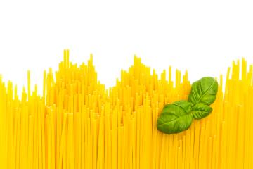 row of spaghetti noodles with basil leaf : Stock Photo or Stock Video Download rcfotostock photos, images and assets rcfotostock | RC-Photo-Stock.:
