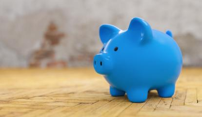 Saving to buy a house or home savings concept with blue piggy bank in a old house- Stock Photo or Stock Video of rcfotostock | RC-Photo-Stock