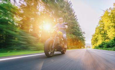 scrambler motorbike on the empty road riding and having fun on a motorcycle tour journey. copyspace for your individual text.- Stock Photo or Stock Video of rcfotostock | RC-Photo-Stock
