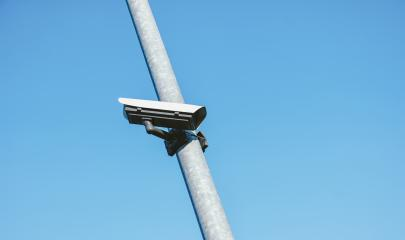 Security camera against blue sky- Stock Photo or Stock Video of rcfotostock | RC-Photo-Stock