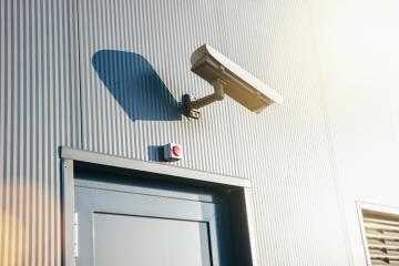 Security camera on a industrial building entrance door- Stock Photo or Stock Video of rcfotostock | RC-Photo-Stock