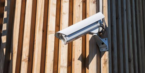 Security camera on a wooden wall- Stock Photo or Stock Video of rcfotostock | RC-Photo-Stock