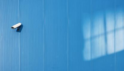 Security camera on the blue wall- Stock Photo or Stock Video of rcfotostock | RC-Photo-Stock