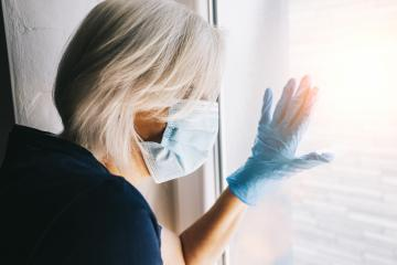 senior woman in wants to break out of isolation from corona COVID-19 quarantine looking out of window to the streets- Stock Photo or Stock Video of rcfotostock | RC-Photo-Stock
