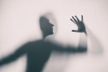 Shadowy human figure behind a frosted glass : Stock Photo or Stock Video Download rcfotostock photos, images and assets rcfotostock | RC-Photo-Stock.: