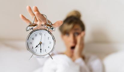 Shocked young woman waking up holding her alarm clock in the morning. Late and Time is running concept image : Stock Photo or Stock Video Download rcfotostock photos, images and assets rcfotostock | RC-Photo-Stock.: