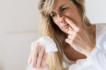 Sick woman Picking his nose. Upset ill european lady sits  in bed, blowing and picks her nose using paper napkin tissue. Cold And Flu Concept : Stock Photo or Stock Video Download rcfotostock photos, images and assets rcfotostock | RC-Photo-Stock.: