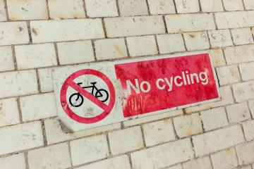 Sign, No Cycling on a dirty brick wall - Stock Photo or Stock Video of rcfotostock | RC-Photo-Stock