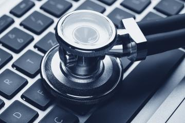 Silver stethoscope lying down on an laptop- Stock Photo or Stock Video of rcfotostock | RC-Photo-Stock