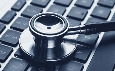 Silver stethoscope lying down on an laptop, blue toned - Stock Photo or Stock Video of rcfotostock | RC-Photo-Stock