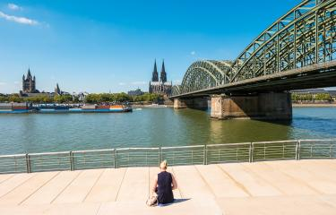 single woman pending the time at the deutzer rhine boulevard at a summer day in Cologne- Stock Photo or Stock Video of rcfotostock | RC-Photo-Stock