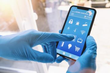 smart home app in coronavirus quarantine to unlock the door of his house. smart home technology interface in a smartphone screen application. Hand holding smart device. - Stock Photo or Stock Video of rcfotostock | RC-Photo-Stock