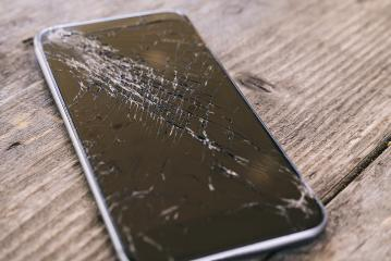 Smartphone display with broken glass on a wodden table- Stock Photo or Stock Video of rcfotostock | RC-Photo-Stock