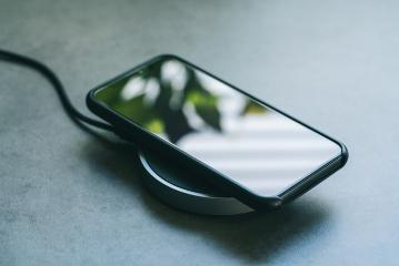 smartphone wireless charging on induction charger. Wireless charger- Stock Photo or Stock Video of rcfotostock | RC-Photo-Stock