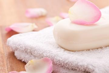 soap with rose leafs on a towel on wooden background- Stock Photo or Stock Video of rcfotostock | RC-Photo-Stock