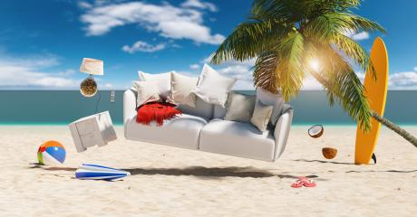 Sofa floats over sand on the beach with palm as a concept for vacation and relaxation- Stock Photo or Stock Video of rcfotostock | RC-Photo-Stock