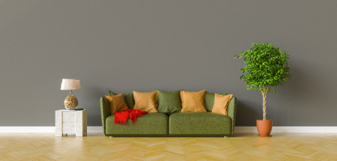 Sofa in a living room on a dark gray wall with copy space on the wall for picture canvas- Stock Photo or Stock Video of rcfotostock | RC-Photo-Stock