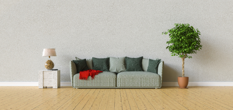 Sofa in a living room on a gray wall with copy space on the wall for picture canvas- Stock Photo or Stock Video of rcfotostock | RC-Photo-Stock