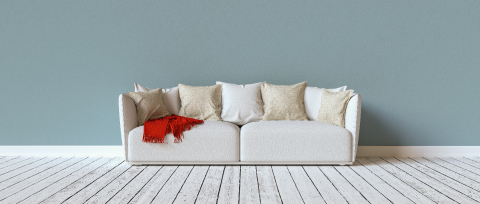 Sofa on a blue wall in a living room with space for canvas, banner size, copyspace for your individual text.- Stock Photo or Stock Video of rcfotostock | RC-Photo-Stock