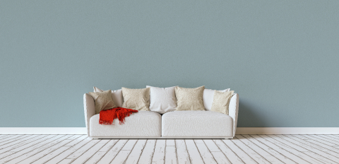 Sofa on a blue wall in living room with space for canvas, banner size, copyspace for your individual text.- Stock Photo or Stock Video of rcfotostock | RC-Photo-Stock