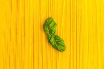 spaghetti noodles background with basil leaf- Stock Photo or Stock Video of rcfotostock | RC-Photo-Stock