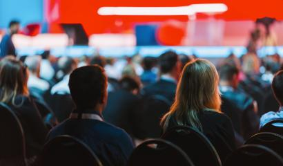 Speaker on the stage with Rear view of Audience in the conference hall or seminar meeting, business and education concept- Stock Photo or Stock Video of rcfotostock | RC-Photo-Stock
