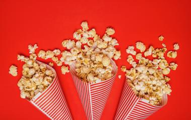 Spilled popcorn in paper bags on a red background, cinema, movies entertainment and carnival concept image : Stock Photo or Stock Video Download rcfotostock photos, images and assets rcfotostock | RC-Photo-Stock.: