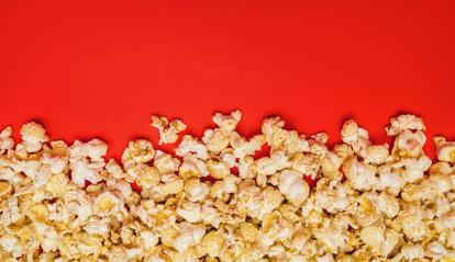 Spilled popcorn on a red background- Stock Photo or Stock Video of rcfotostock | RC-Photo-Stock