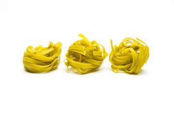 Spinach noodle pasta nests in a row- Stock Photo or Stock Video of rcfotostock | RC-Photo-Stock