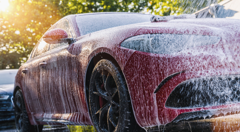 Spraying foam to a red car with high pressure foam gun car wash at car wash service- Stock Photo or Stock Video of rcfotostock | RC-Photo-Stock
