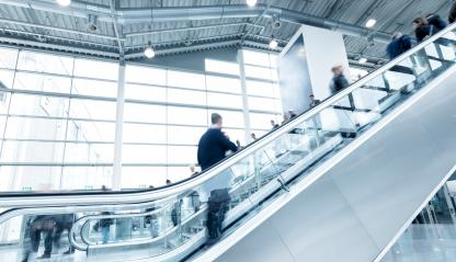 staircases at a traid fair with blurred people- Stock Photo or Stock Video of rcfotostock | RC-Photo-Stock