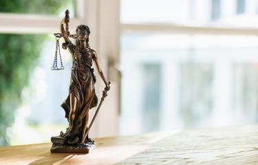 Statue of Justice - lady justice or Iustitia / Justitia the Roman goddess of Justice in a lawyer office, including copy space : Stock Photo or Stock Video Download rcfotostock photos, images and assets rcfotostock | RC-Photo-Stock.:
