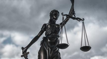 Statue of Justice symbol with dark clouds- Stock Photo or Stock Video of rcfotostock | RC-Photo-Stock