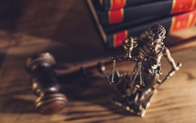 Statue of Justice with gavel in a courtroom. law, advice and justice concept image- Stock Photo or Stock Video of rcfotostock | RC-Photo-Stock