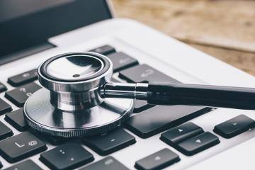Stethoscope on a notebook - Virus alert concept image- Stock Photo or Stock Video of rcfotostock | RC-Photo-Stock