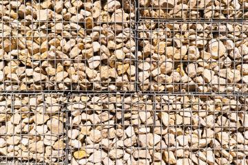 Stone wall in metallic net - Stock Photo or Stock Video of rcfotostock | RC-Photo-Stock