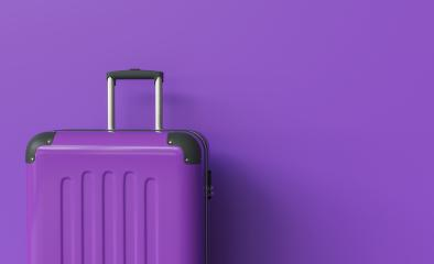 Suitcase on purple background. travel concept, with copy space for individual text- Stock Photo or Stock Video of rcfotostock | RC-Photo-Stock