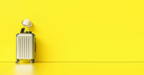 Suitcase with hat, sunglasses and smartphone on yellow background. travel concept, with copy space for individual text- Stock Photo or Stock Video of rcfotostock | RC-Photo-Stock
