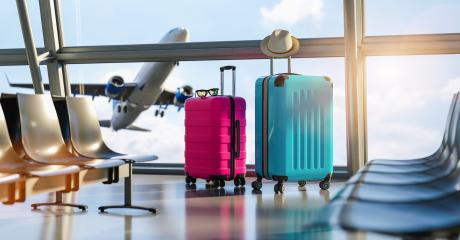 Suitcases in airport departure lounge, airplane in background, summer vacation concept, traveler suitcases in airport terminal waiting area, empty hall interior with large windows, focus on suitcases- Stock Photo or Stock Video of rcfotostock | RC-Photo-Stock