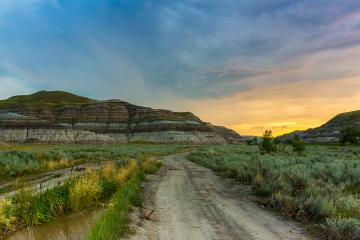 sundawn on a cloudy sky at drumheller mountans canada : Stock Photo or Stock Video Download rcfotostock photos, images and assets rcfotostock | RC-Photo-Stock.: