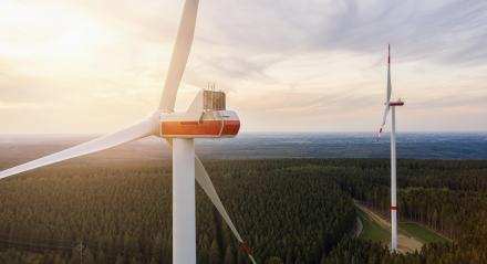 sunset above wind turbines - Energy Production with clean and Renewable Energy- Stock Photo or Stock Video of rcfotostock | RC-Photo-Stock