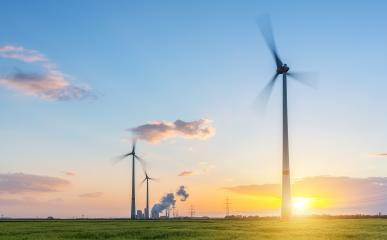 Sunset at a wind farm with coal power plant at sunset : Stock Photo or Stock Video Download rcfotostock photos, images and assets rcfotostock | RC-Photo-Stock.: