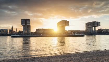 Sunset at the rhine shore in cologne at with crane houses- Stock Photo or Stock Video of rcfotostock | RC-Photo-Stock