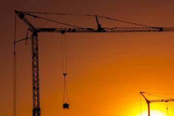 Sunset behind a Construction site silhouette building with cranes : Stock Photo or Stock Video Download rcfotostock photos, images and assets rcfotostock | RC-Photo-Stock.: