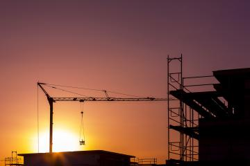 sunset sun dawn at Construction site building crane technology : Stock Photo or Stock Video Download rcfotostock photos, images and assets rcfotostock | RC-Photo-Stock.: