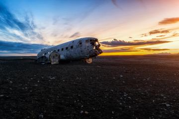 sunset View of a plane wreck in iceland- Stock Photo or Stock Video of rcfotostock | RC-Photo-Stock