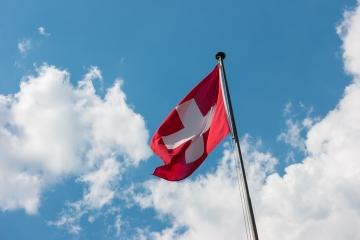 Swiss Flag with Cloudy Sky- Stock Photo or Stock Video of rcfotostock   RC-Photo-Stock
